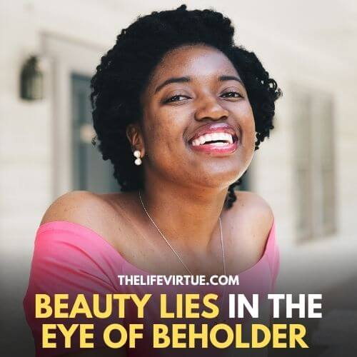 black woman smiling proudly & owning her beauty - dealing with being ugly