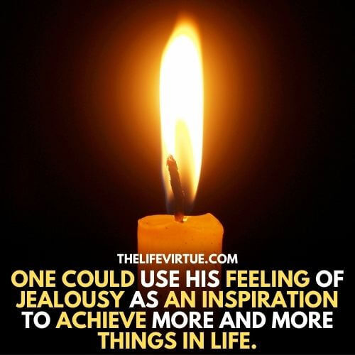 A candle is burning which is an indication of an inspiration a person can get from jealousy